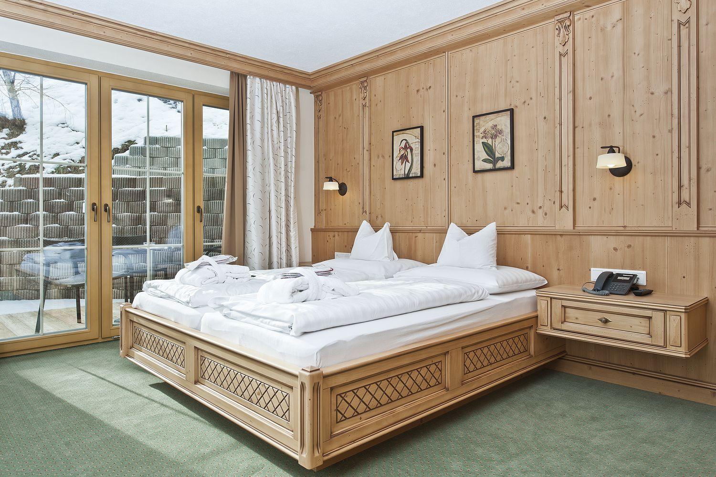 Doppelbett in der Suite Zillertal