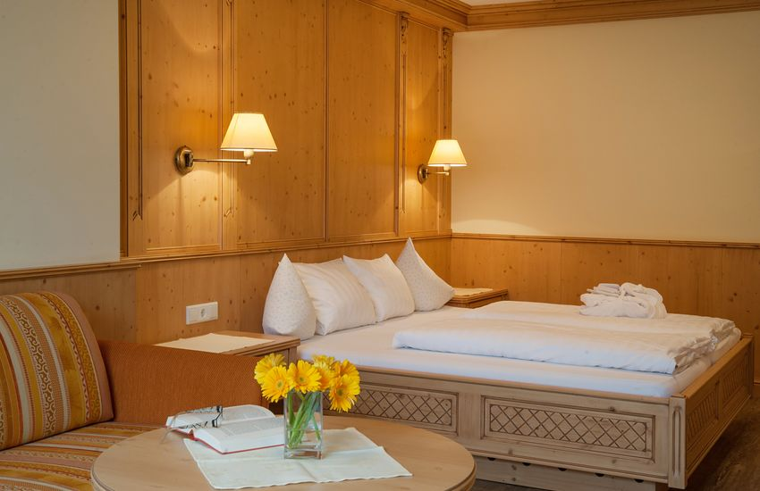 Doppelbett in der Juniorsuite Tirol